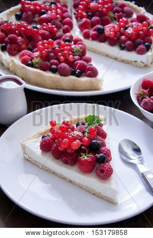 Homemade Berry tart with raspberry and currant