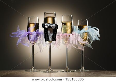 Set of stylish decorated champagne glasses for party