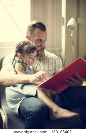 Father Daughter Reading Book Concept