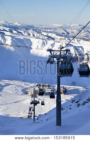Gondola Lift On Ski Resort At Sun Evening