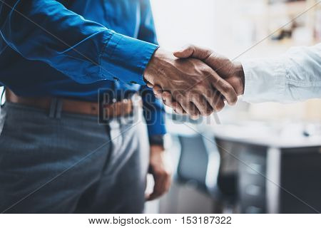 Business partnership handshake concept.Photo of two businessmans handshaking process.Successful deal after great meeting.Horizontal, blurred background