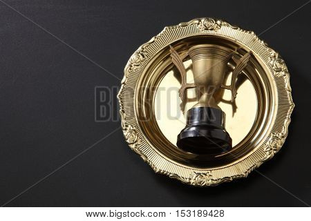 trophy in a golden tray