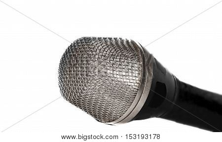 Part of the microphone on light background