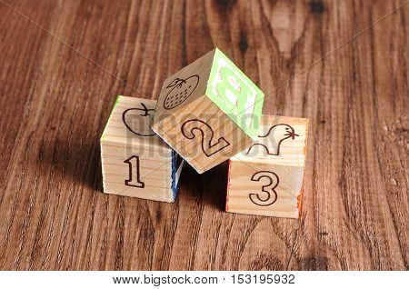 Alphabet blocks 123 isolated on a wooden background