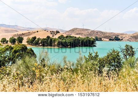 Rural landscape with farmland and wind turbines near Ardales, Malaga Province, Andalusia, Spain