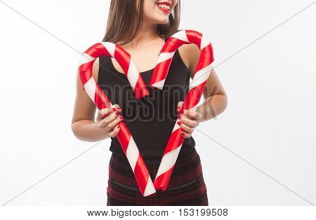 Young Beautiful Girl With Red Lips With Christmas Candy As Heart Isolated White Background