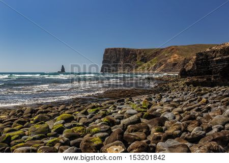 Sea scape stone needle. Portugal Aljezur Algarve, long exposure.