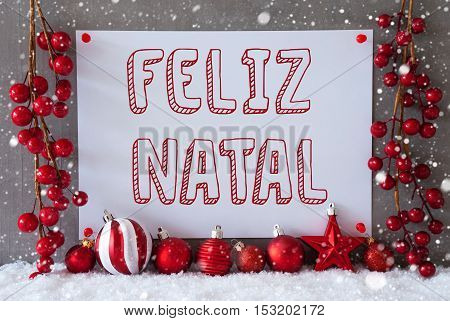 Label With Portuguese Text Feliz Natal Means Merry Christmas. Red Christmas Decoration Like Balls On Snow. Urban And Modern Cement Wall As Background With Snowflakes.