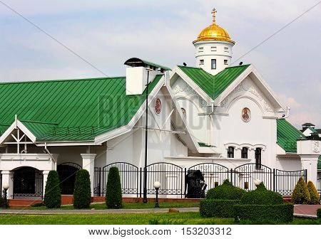 Orthodox Church with golden dome in the city square