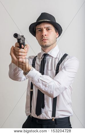 Young Detective Is Aiming With Gun With Silencer.