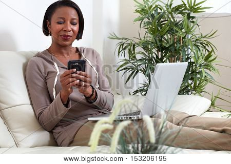African-American woman with smartphone.