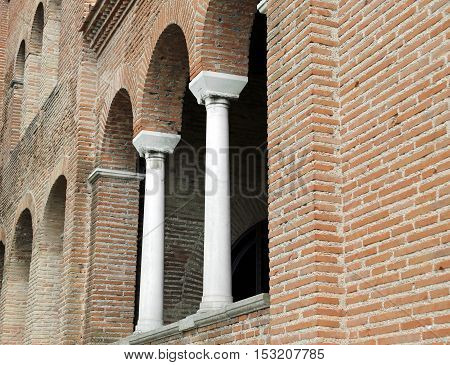 Arched Windows And Columns On The Facade Of An Old Medieval Chur