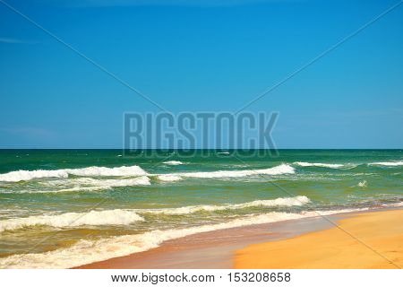 Baltic sea with waves and sand. Baltic summer