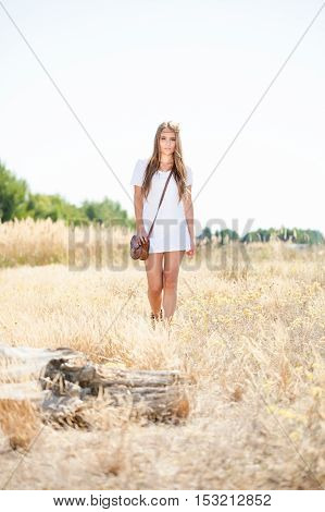 Beautiful Hippie Looking Girl Approaching A Tree Stump At A Meadow