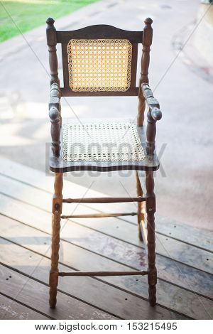 Vintage high chair on outdoor porch floor