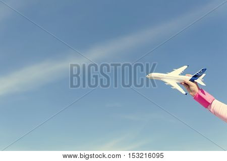Little Girl Playing Toy Plane Concept