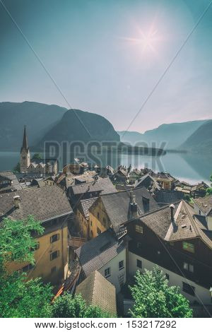 Sunny summer day in the Hallstatt village in the Austrian Alps. Maria am Berg church and Hallstattersee lake, Austria, Europe. Toned like Instagram filter