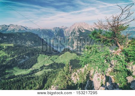Beautiful view from top of cableway above the Konigsee lake on Schneibstein mountain ridge. Border of German and Austrian Alps, Europe. Toned like Instagram filter