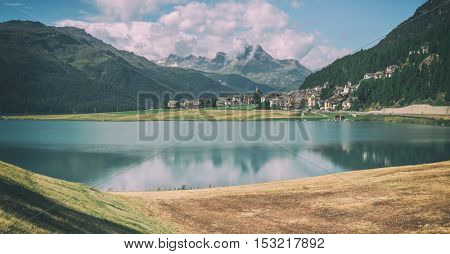 Amazing sunny day at Champferersee lake in the Swiss Alps. Silvaplana village, Switzerland, Europe. Toned like Instagram filter