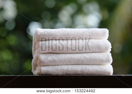 fluffy bath towels stack on the wood table
