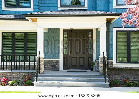 A nice entrance of a luxury house with flight of steps in front