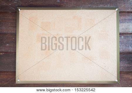 Blank board on wooden wall, stock photo