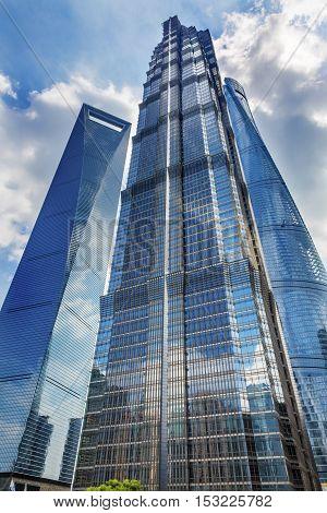 SHANGHAI, CHINA - SEPTEMBER 23, 2016 Jin Mao Tower Three Skyscrapers Reflections Make Patterns and Designs Liujiashui Financial District Shanghai China. Shanghai Tower andShanghai World Financial Center