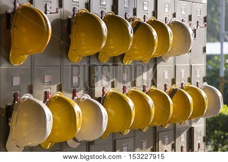 Safety helmets hanging on locker for worker equipment