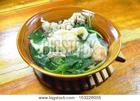 boiled shrimp dumpling with spinach and minced pork in hot soup