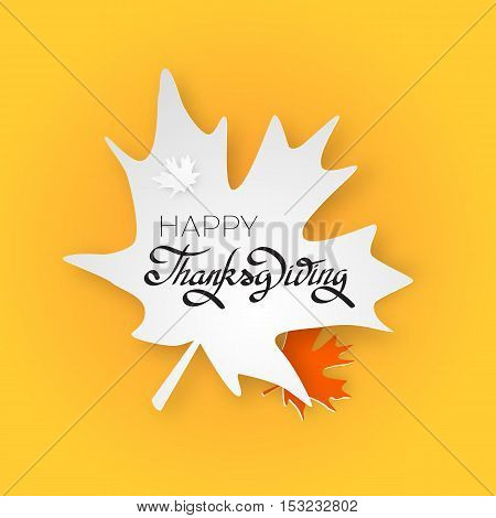 Happy thanksgiving day greeting card with hand lettering on yellow background. Give thanks black text on white maple leaf