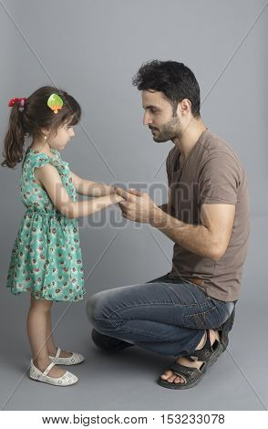 Small girl with old boy isolated inside studio