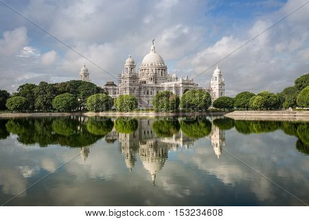 Victoria Memorial historic architectural monument with beautiful water reflections and moody sky.