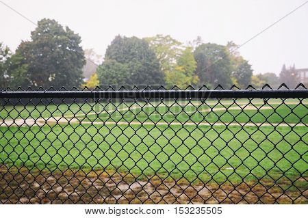 rain on an empty sports field. the concept of the abolition of the sports games or training due to bad weather