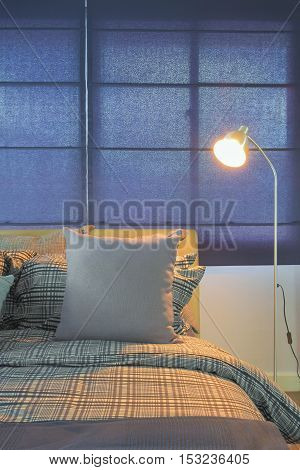 Floor Lamp Next To Comfy Bed In Night Time