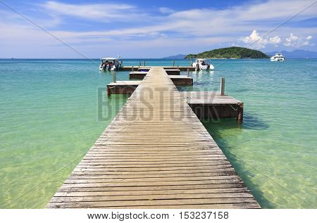 koh mak beach or mak island harbour and speed boat on clear sky and sea at Trat Province in Thailand