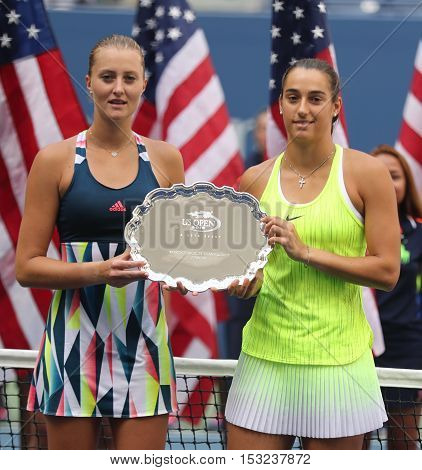 NEW YORK - SEPTEMBER 11, 2016: US Open 2016 women doubles runners up Caroline Garcia(L) and Kristina Mladenovic of France during trophy presentation at the Billie Jean King National Tennis Center