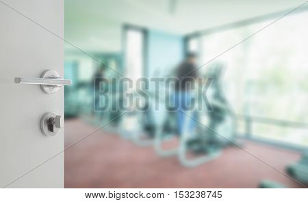 Opened White Door To Fitness Center Abstract Blur Background.