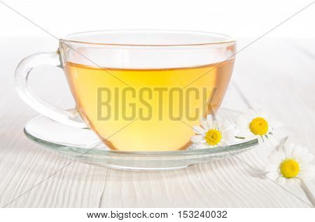 Cup Of Medicinal Chamomile Tea On The Wooden Table