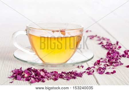 Rose Tea And Dried Petals On White Wooden Table