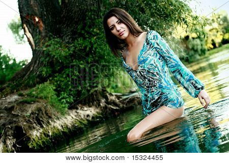 Beautiful Girl Bathing In A Lake