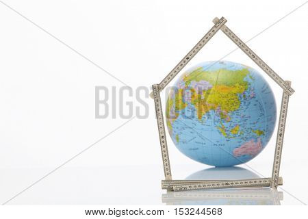 Asian country  with the fold able ruler folded into a house shape