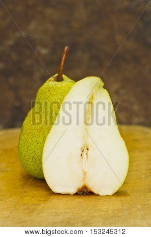 tasty fresh pear on a wooden cutting board