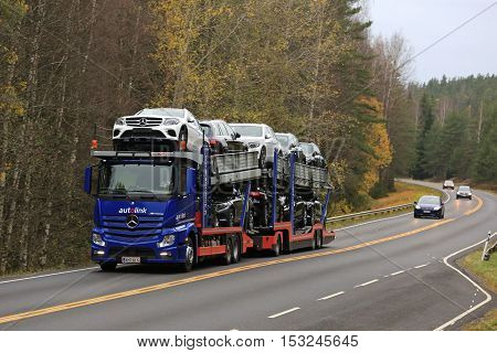 SALO FINLAND - OCTOBER 22 2016: Mercedes-Benz Actros car transporter hauls new Mercedes-Benz cars along autumnal road in South of Finland.