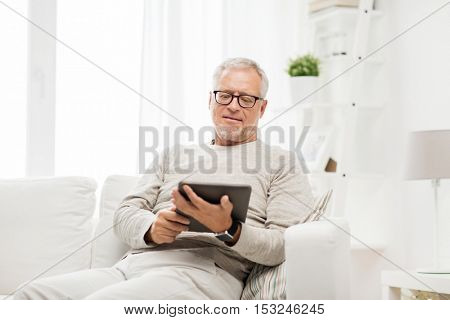 technology, people and lifestyle, distance learning concept - senior man with tablet pc computer at home