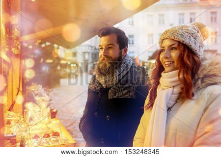 holidays, winter, christmas and people concept - happy couple in warm clothes outdoors