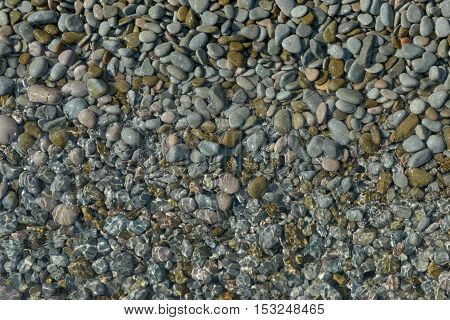 Close-up View Of Wet And Underwater Pebble As Background.