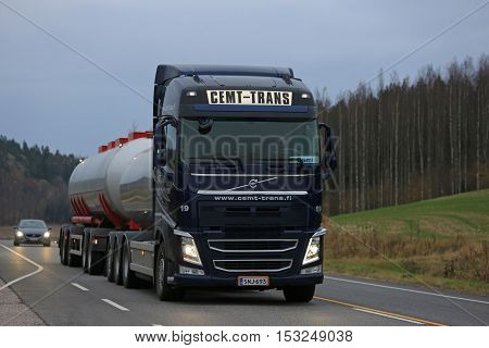 SALO FINLAND - OCTOBER 22 2016: Dark blue Volvo FH tank truck of Cemt-Trans moves along highway in South of Finland late in the evening.