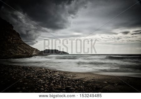 Smooth water with long exposure shot, sea waves on the beach