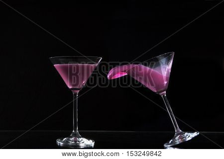 pair of cocktail glasses with colored water