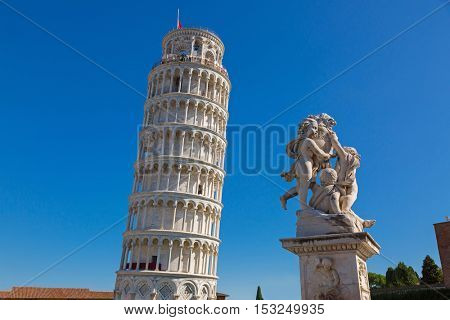 PISA, ITALY - SEPTEMBER 2016 : World famous Leaning Tower of Pisa, status of cherubs winged angels in Pisa, Italy on September 22, 2016. Pisa Tower is a freestanding bell tower campanile of cathedral